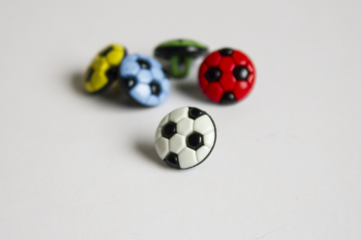 WHITE FOOTBALL-SHAPED BUTTON